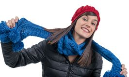 Young smiling brunette woman with a winter cap. A young smiling brunette woman with a winter cap Stock Photography