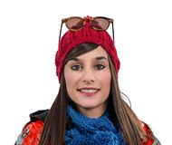 Young smiling brunette woman with a winter cap, on white Royalty Free Stock Photo