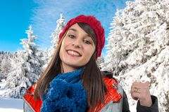 Young smiling brunette woman with a winter cap. A young smiling brunette woman with a winter cap Stock Image