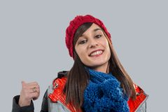 Young smiling brunette woman with a winter cap. A young smiling brunette woman with a winter cap Stock Images