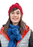 Young smiling brunette woman with a winter cap. A young smiling brunette woman with a winter cap Royalty Free Stock Photography