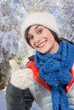 Young smiling brunette woman with a winter cap Stock Photography