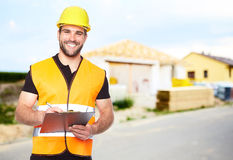 Young smiling builder writes on a black folder Stock Images