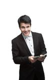Young smiling business man holding money Royalty Free Stock Photos