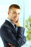 Young smiling business man standing Stock Photos