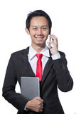 Young smiling business man talking with mobile phone  Royalty Free Stock Images