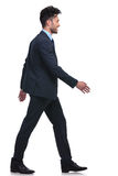 Young smiling business man walking forward Stock Photography