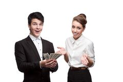 Young smiling business people holding money Stock Photo
