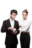 Young smiling business people holding money Royalty Free Stock Images