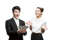 Young smiling business people holding money Royalty Free Stock Image