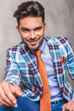 Young smiling business on studio background. Royalty Free Stock Images