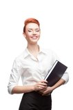 Young smiling business woman holding diary Stock Photo