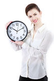 Young Smiling Business woman holding in hands clock, isolated on. White background Royalty Free Stock Photos