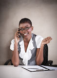 Young smiling business woman on phone call. At desk Stock Photos