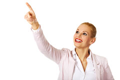 Young smiling business woman pointing for copyspace or something Royalty Free Stock Image