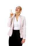 Young smiling business woman pointing up Royalty Free Stock Photography