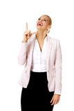 Young smiling business woman pointing up Stock Photos