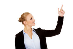 Young smiling business woman pointing up Stock Images