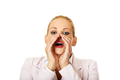 Young smiling business woman screaming loud or calling someone Stock Image