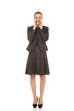 Young smiling business woman screaming loud or calling someone Royalty Free Stock Photography