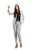 Young smiling business woman taking selfie with mobile phone. Full body length portrait isolated over white studio background Stock Image
