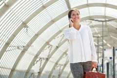 Young smiling business woman talking on cellphone Royalty Free Stock Images
