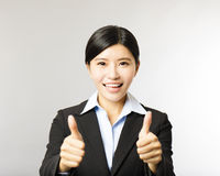 Young smiling business woman with thumb up gesture Royalty Free Stock Image