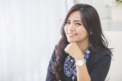 Young smiling business woman working in her office Stock Photos