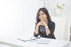 Young smiling business woman working on her paperwork Stock Photography