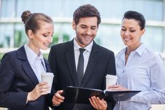 Young smiling business women and business man. Royalty Free Stock Photo