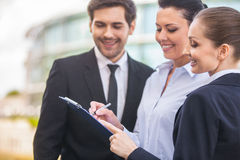Young smiling business women and business man. Royalty Free Stock Images