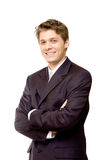Young smiling businessman. Handsome young businessman smiling with his arms crossed Stock Photography