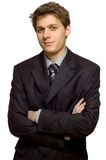 Young smiling businessman. With arms crossed Stock Photo