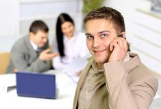 Young smiling businessman calling Stock Photos
