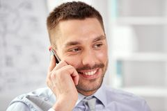 Young smiling businessman calling on smartphone Stock Image