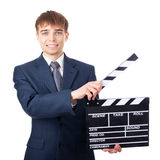Young smiling businessman with clapperboard Stock Photos