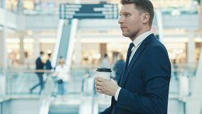Young smiling businessman with coffee Royalty Free Stock Photo