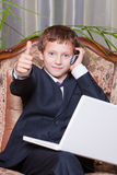 Young smiling businessman with computer showing ok Royalty Free Stock Photos