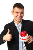 Young smiling businessman with gift  box Stock Photo