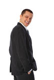 Young smiling businessman half turn. On white background Royalty Free Stock Photos