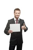 Young smiling businessman holding sign Stock Image