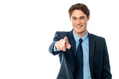 Young smiling businessman pointing you out Stock Photos