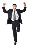 Young smiling businessman with raised hands Royalty Free Stock Images