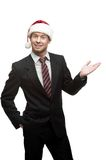 Young smiling businessman in santa hat Stock Photo