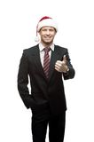 Young smiling businessman in santa hat Royalty Free Stock Photography