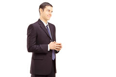 Young smiling businessman shot during a conversation Royalty Free Stock Photos