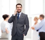 Young smiling businessman with smartphone Royalty Free Stock Images