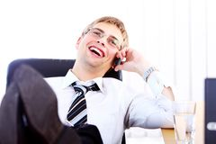 Young smiling businessman using cell phone Stock Photography