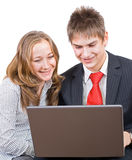 Young smiling businesspeople. Young sweet smiling couple in the business Royalty Free Stock Photo