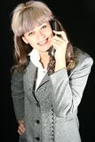 Young smiling businesswoman. Businesswoman talking on the phone Stock Photo